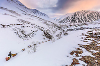 Wade Marrs on the trail along Pass Creek in the Alaska Range after leaving the Rainy Pass Checkpoint on the way to Rohn during Iditarod 2016.  Alaska.  March 07, 2016.  <br /> <br /> Photo by Jeff Schultz (C) 2016 ALL RIGHTS RESERVED