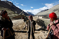 China started building a controversial 67-mile &quot;paved highway fenced with undulating guardrails&quot; to Mount Qomolangma, known in the west as Mount Everest, to help facilitate next year's Olympic Games torch relay./// Tibetans work with shovels and their bare hands building the road to Everest Base Camp.<br /> Tibet, China<br /> July, 2007