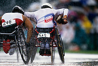 Two paralympic cyclists competing in a race