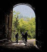 Photo by Stephen Brashear.From left, Cynthia McMath, left, of Cynthia McMath of Lynnwood, Wash., Richard Chou of Kirkland, Wash., and Lorna Johnston of Bothell, Wash., head into the Snoqualmie Pass tunnel on the John Wayne Pioneer Trail between Hyak, Wash., and Rattlesnake Lake near North Bend, Wash., Sunday Aug. 17, 2008.