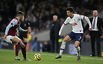 Tottenham's Son Heung-min is challenged by Burnley's Matthew Lowton during the Premier League match at the Tottenham Hotspur Stadium, London. Picture date: 7th December 2019. Picture credit should read: Paul Terry/Sportimage