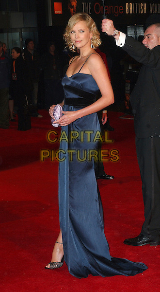 CHARLIZE THERON.The 2006 Orange British Academy Film Awards, Odeon Leicester Square, London, UK..February 19th, 2006.Ref: BEL.full length blue dress purple clutch purse bafta baftas.www.capitalpictures.com.sales@capitalpictures.com.© Capital Pictures.