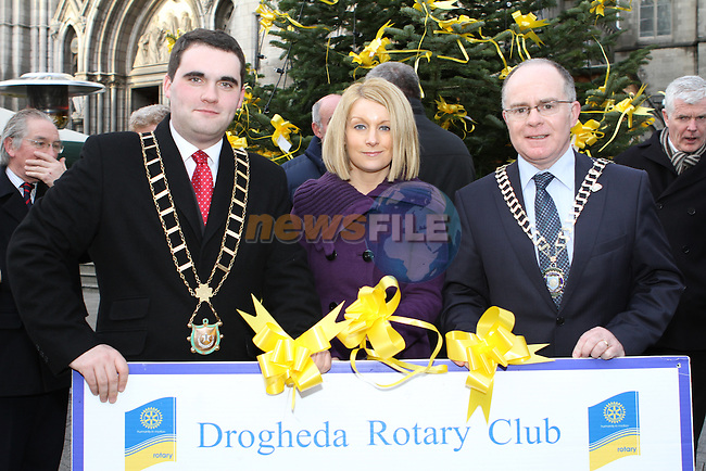 Mayor Kevin Callan, Karen Smyth from the Drogheda Homeless Aid and Drogheda Rotary President Donagh O'Brien at the Launch of the Rotary Tree on West Street...(Photo credit should read Jenny Matthews www.newsfile.ie)....This Picture has been sent you under the conditions enclosed by:.Newsfile Ltd..The Studio,.Millmount Abbey,.Drogheda,.Co Meath..Ireland..Tel: +353(0)41-9871240.Fax: +353(0)41-9871260.GSM: +353(0)86-2500958.email: pictures@newsfile.ie.www.newsfile.ie.