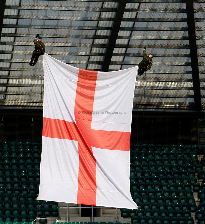 Photo: Richard Lane/Richard Lane Photography. London Wasps v Bath Rugby. Aviva Premiership. St George's Day  Game. 23/04/2011. Wasps' St George's Flag abseil.