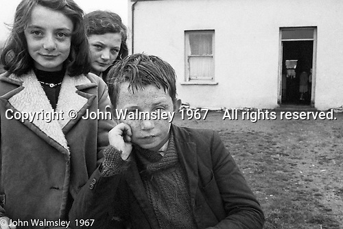 "Three kids and their home, Dunquin (in Gaelic, Dún Chaoin, meaning ""Caon's stronghold""), on the tip of the Dingle Peninsula, County Kerry, Ireland.  1971."