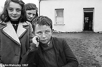 """Three kids and their home, Dunquin (in Gaelic, Dún Chaoin, meaning """"Caon's stronghold""""), on the tip of the Dingle Peninsula, County Kerry, Ireland.  1971."""