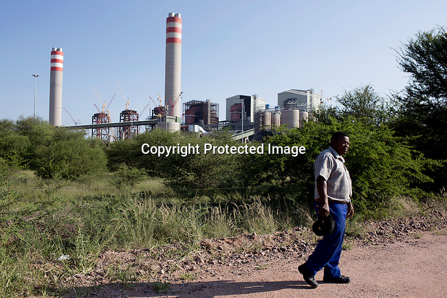 Stephens Tibanyane, a man fighting for the access to family graves inside the newly constructed Medupi power station stands outside the northern South African town of Lephalale. The plant, operated by the state company Eskom will be the fourth largest in the world and is expected to produce electricity in early 2015. Medupi is touted as Africa's first 'supercritical' coal plant, using higher temperatures that produce more energy from less coal, while emitting less ash and carbon dioxide.