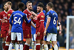 Alex Oxlade Chamberlain of Liverpool and Beni Baningime of Everton at the end of the premier league match at Goodison Park Stadium, Liverpool. Picture date 7th April 2018. Picture credit should read: Robin Parker/Sportimage