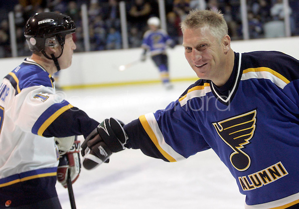 (Sunday, December 03, 2006)-Brett Hull, right, congratulates Blake Dunlop on a goal during St. Louis Blues Alumni Hockey Game at the Summit Center in Chesterfield.  Brett Hull's number, 16, was retired.