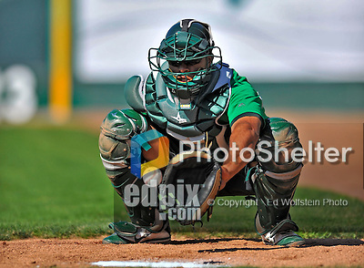29 June 2012: Vermont Lake Monsters' catcher Diomedes Lopez warms up prior to a game against the Lowell Spinners at Centennial Field in Burlington, Vermont. Mandatory Credit: Ed Wolfstein Photo