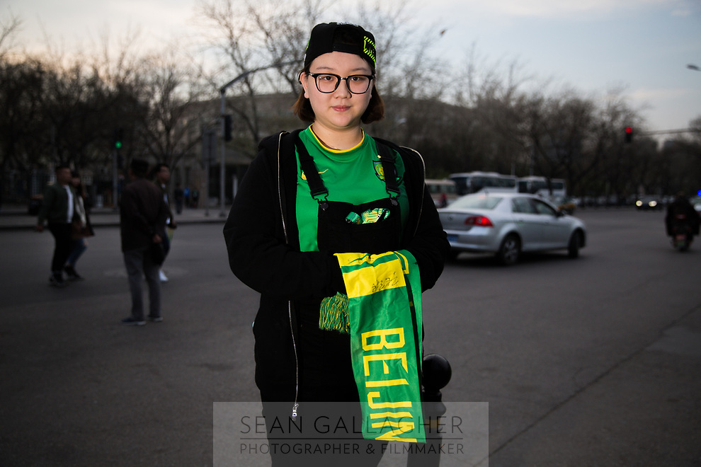 Day Jing, 23, a fan of Chinese Super League football team Beijing Guo'an wait outside the Worker's Stadium in Beijing before their team's game with Shanghai Shenhua. 2nd April, 2017.