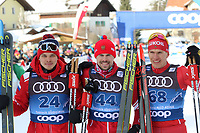 31st December 2019; Dobbiaco, Toblach, South Tyrol, Italy;  FIS Tour de Ski - Cross Country Ski World Cup 2019  in Dobbiaco, Toblach, on December 31, 2019; Mens individual 15km  Ivan Yakimushkin of Russia, Sergey Ustiugov of Russia and Alexander Bolshunov of Russia celebrate on the podium