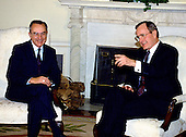 Washington, D.C. - (FILE) -- United States President George H.W. Bush, right, meets Foreign Minister Moshe Arens of Israel in the Oval Office of the White House in Washington, D.C. on Monday, March 13, 1989..Credit: Arnie Sachs / CNP