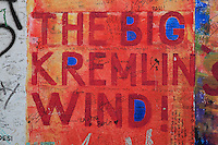 Section of the Berlin Wall depicting a detail of the painting Big Kremlin's Wind by Theodor Tehzik, damaged by graffiti, part of the East Side Gallery, a 1.3km long section of the Wall on Muhlenstrasse painted in 1990 on its Eastern side by 105 artists from around the world, Berlin, Germany. Picture by Manuel Cohen