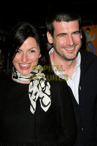 "DAVINA McCALL & MATTHEW ROBERTSON.""The Boat That Rocked"" world film premiere at The Odeon, Leicester Square, London, England..March 23rd, 2009.headshot portrait white print scarf black stubble facial hair married husband wife .CAP/AH.©Adam Houghton/Capital Pictures."