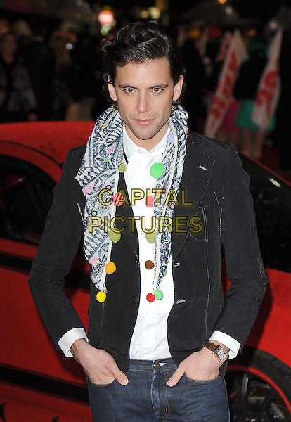"MIKA (Michael Holbrook Penniman Jr.).Attending The European Premiere of ""Kick-Ass"", Empire Leicester Square, London, England, UK, .22nd March 2010..arrivals half length pompoms pom poms scarf multi-coloured white shirt black jacket hands in pockets jeans wrist watch .CAP/BEL.©Tom Belcher/Capital Pictures."