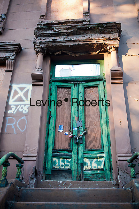 Dilapidated brownstone is for sale and awaiting restoration, in Harlem in New York on Thursday, October 11, 2012. (© Richard B. Levine)