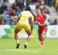 Wales's Gareth Davies looks to make a pass before a tackle comes in from Australia's Pama Fou<br /> <br /> Australia Vs Wales - Men's quarter-final<br /> <br /> Photographer Chris Vaughan/CameraSport<br /> <br /> 20th Commonwealth Games - Day 4 - Sunday 27th July 2014 - Rugby Sevens - Ibrox Stadium - Glasgow - UK<br /> <br /> © CameraSport - 43 Linden Ave. Countesthorpe. Leicester. England. LE8 5PG - Tel: +44 (0) 116 277 4147 - admin@camerasport.com - www.camerasport.com