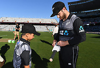 Captains Kane Williamson signs an autograph for the ANZ coin toss winner. New Zealand Black Caps v Australia.Tri-Series International Twenty20 cricket. Eden Park, Auckland, New Zealand. Friday 16 February 2018. © Copyright Photo: Andrew Cornaga / www.Photosport.nz