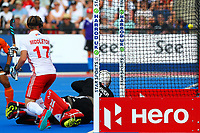 Englands Barry Middleton and goalie George Pinner are unable to stop a Malaysian goal during the Hockey World League Semi-Final Pool A match between England and Malaysia at the Olympic Park, London, England on 17 June 2017. Photo by Steve McCarthy.