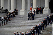 The flag-draped casket of former President George H.W. Bush is carried by a joint services military honor guard from the U.S. Capitol, Wednesday, Dec. 5, 2018, in Washington. <br /> Credit: Alex Brandon / Pool via CNP