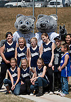 April 7, 2012:   Nevada Wolf Pack mascots Wolfie and Alfie Jr. pose with the Sparks fastpitch 10-under Wolf Pack team before the Nevada vs San Jose State Spartans game played at Christina M. Hixson Softball Park on Saturday in Reno, Nevada.