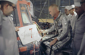 "Astronaut John Glenn and technicians inspect artwork that will be painted on the outside of his Mercury spacecraft on February 2, 1962. John Glenn nicknamed his capsule ""Friendship 7"". On February 20, 1962 astronaut John H. Glenn Jr. lifted off into space aboard his Mercury Atlas (MA-6) rocket and became the first American to orbit the Earth. After orbiting the Earth 3 times, Friendship 7 landed in the Atlantic Ocean 4 hours, 55 minutes and 23 seconds later, just East of Grand Turk Island in the Bahamas. Glenn and his capsule were recovered by the Navy Destroyer Noa, 21 minutes after splashdown..Credit: NASA via CNP"