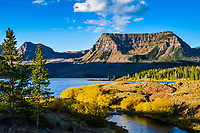 The Flat Tops Wilderness Area, located in central Colorado is the third largest wilderness area in the State. Set aside by Congress in 1975 and comprised of over 230,000 acres, only one 82 mile road traverses the area. Here, Amphitheater Mountain rises above Trappers lake in the heart of the area.