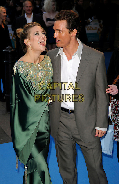 """KATE HUDSON & MATTHEW McCONAUGHEY.""""Fool's Gold"""" UK film premiere, Vue Leicester Square, London, England..April 10th, 2008.half 3/4 length green gold silk satin patterned pattern kimono dress sleeves grey gray suit profile mouth open laughing .CAP/CAN.©Can Nguyen/Capital Pictures."""