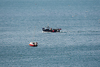 Aberystwyth Wales Uk, Sunday 08 May 2016<br /> Pictured: Work and leisure - A small fishing boat returns to harbour passing a pleasure sail boat.<br /> UK Weather : As temperatures reach the upper 20's centigrade in parts of Britain, people enjoy the warm May sunshine in Aberystwyth on the Cardigan Bay coast in West Wales.