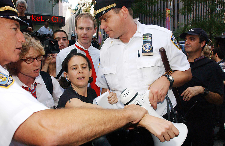 "8/31/04.2004 REPUBLICAN NATIONAL CONVENTION/FOX NEWS PROTEST--Andrea Buffa is arrested during a ""shut-up-a-thon"" protest by  several anti-Bush groups at the building which houses Fox News at 1211 Avenue of the Americas. Among other chants, they yelled ""Shut up!"", which, according to the groups, is Fox News Bill O'Reilly's ""trademark line."".CONGRESSIONAL QUARTERLY PHOTO BY SCOTT J. FERRELL"