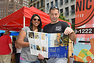 A couple looking at a brochure for South Africa Tourism.