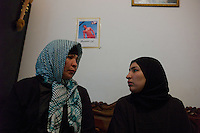 Tunis, January 16, 2011.Zaida Mamnai, (left) with her daughter under the picture of her dead son, he was called Hilmi Mamnai, was 23 years old and died from a bullet wound to the chest during a demonstration in central tunis last thursday afternoon..