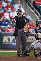 Umpire Jake Wilburn makes a strike call during a game between the Frisco RoughRiders and Springfield Cardinals on June 4, 2015 at Hammons Field in Springfield, Missouri.  Frisco defeated Springfield 8-7.  (Mike Janes/Four Seam Images)