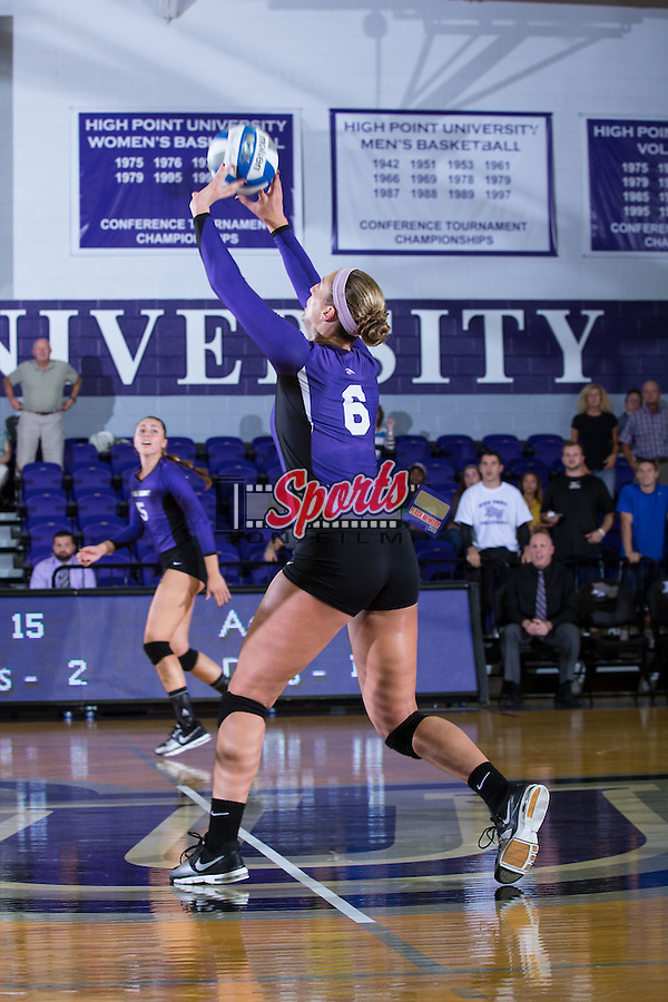 Megan Kennedy (6) of the High Point Panthers sets the ball during the match against the UNC Greensboro Spartans at Millis Athletic Center on September 16, 2014 in High Point, North Carolina.  The Panthers defeated the Spartans 3-0.   (Brian Westerholt/Sports On Film)