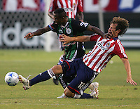 Chivas USA defender Carey Talley (12) and   Santos Laguna forward Christian Benitez (11). Chivas USA defeated the Santos of Laguna 1-0 during the 1st round of the 2008 SuperLiga at Home Depot Center stadium, in Carson, California on Wednesday, July 16, 2008.