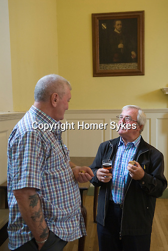 Jankyn Smyth Cake and Ale ceremony at the Guildhall, Bury St Edmunds Suffolk 2015. Portrait of  Jankyn Smyth (died 1481) residents of the Almshouses  enjoy cake and ale during the annual ceremony after the Commemoration service in St Marys Church.