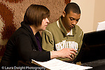 Middle School grade 8 music education male student in piano lesson with female teacher horizontal
