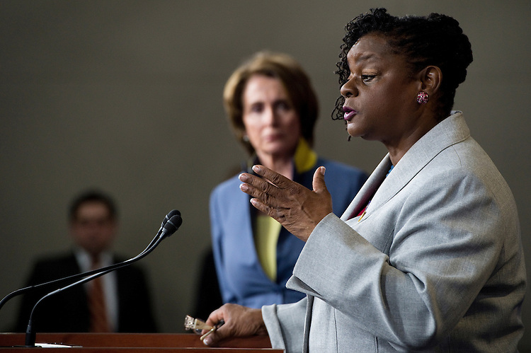 UNITED STATES - MAY 16: Rep. Gwen Moore, D-Wisc., recounts her own personal experiences with violence and rape as House Minority Leader Nancy Pelosi listens during the House Democrats' news conference in the Capitol on the Violence against Women Act on Wednesday, May 16, 2012. (Photo By Bill Clark/CQ Roll Call)
