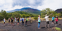 Panoramic photo of tourists on a Mount Etna Volcano Tour, exploring an old lava flow, Sicily, UNESCO World Heritage Site, Italy, Europe. This is a panoramic photo of tourists on a Mount Etna Volcano Tour, exploring an old lava flow, Sicily, UNESCO World Heritage Site, Italy, Europe.