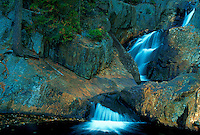 Waterfalls over rocks. Sandy River, Maine