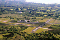 Pictured: Swansea Airport, Wales. Monday 06 June 2011.<br /> Re: The four people killed in the explosion and fire at the Chevron oil refinery in Pembrokeshire have been named.<br /> They were Julie Jones, 54, a fire guard from Pembroke, and three men from Milford Haven: Dennis Riley, 52, Robert Broome, 48, and Andrew Jenkins, 33.<br /> Ms Jones was a mother of one and grandmother, Mr Riley a father of two and grandfather, Mr Broome a father of seven and Mr Jenkins had young twins.<br /> A fifth person is critical but stable after Thursday's blast at Pembroke.<br /> Churches are opening their doors to allow people to say prayers for the victims, with books of condolence available and priests offering support.<br /> <br />  <br /> It could be some time before the cause of the explosion is known Dyfed-Powys Police said the bodies were removed from the scene on Friday night.