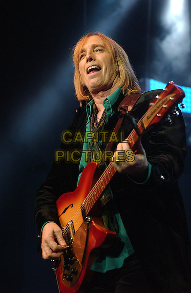 "TOM PETTY - TOM PETTY AND THE HEARTBREAKERS .Performs on their ""Highway Companion Tour"" held at the Post-Gazette Pavilion, Pittsburgh, Pennsylvania, USA..August 16th, 2006.Ref: ADM/JN.stage concert live gig performance music half length black guitar .www.capitalpictures.com.sales@capitalpictures.com.©Jason L Nelson/AdMedia/Capital Pictures."