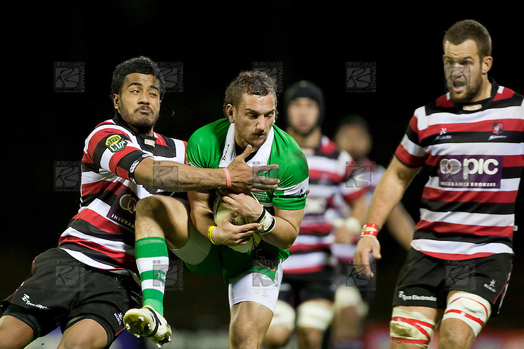 Aaron Cruden is tackled by Reynold Lee-Lo as he lands from taking the ball.  ITM Cup Championship Division Round 2 rugby game between Counties Manukau Steelers and Manawatu, played at Bayer Growers Stadium Pukekohe, on Wednesday July 20th 2011. Counties Manukau won the game 32 - 25 after leading 19 - 18 at halftime.
