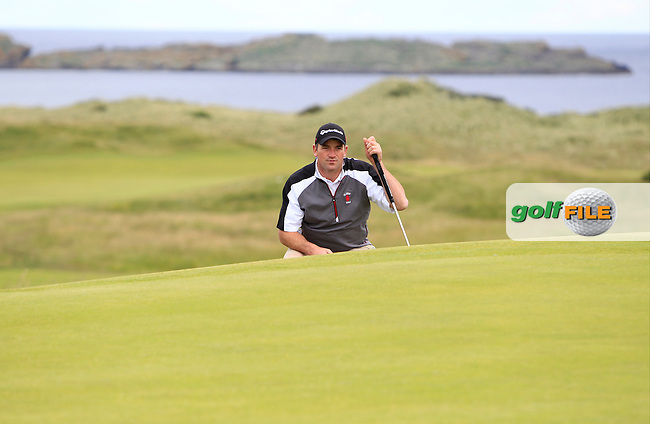 William Hanna (Kilkeel) on the 3rd green during Round 1 Matchplay of the North of Ireland Amateur Open Championship at Royal Portrush, Dunluce Course on Wednesday 15th July 2015.<br /> Picture:  Golffile   Thos Caffrey