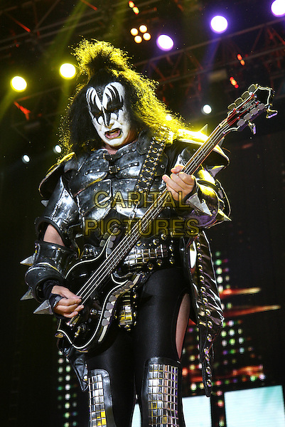 KISS - Gene Simmons.Performing live at Wembley Arena, London, England..May 13th, 2010.band group stage concert live gig performance music costume make-up black white half length silver guitar armour tongue cape leather bass.CAP/MAR.© Martin Harris/Capital Pictures.