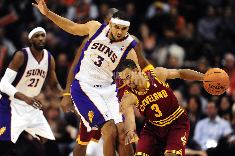 Jan. 12, 2012; Phoenix, AZ, USA; Cleveland Cavaliers guard Ramon Sessions (right) under pressure from Phoenix Suns forward Jared Dudley at the US Airways Center. The Cavaliers defeated the Suns 101-90. Mandatory Credit: Mark J. Rebilas-USA TODAY Sports