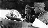 BNPS.co.uk (01202 558833)Pic:    Pen&Sword/BNPS<br /> <br /> General Rommel inside an armoured vehicle during operations in El Alamein.<br /> <br /> Fascinating rare photos of Rommel's feared Afrika Korps which terrorised the Allies in the desert have come to light in a new book.<br /> <br /> Under the direction of legendary German commander Field Marshal Erwin Rommel, who was nicknamed the Desert Fox, the corps were recognised as a superb fighting machine.<br /> <br /> They achieved their greatest triumph when they outmanoeuvred the British at the Battle of Gazala in June 1942 which led to them capturing Tobruk in Libya.<br /> <br /> But they were ultimately defeated in the iconic Battle of Alamein when they succumbed to an offensive led by Field Marshal Bernard Montgomery.