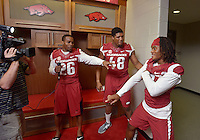 NWA Democrat-Gazette/BEN GOFF • @NWABENGOFF<br /> Rohan Gaines, defensive back (from left), defensive lineman Deatrich Wise, Jr. and defensive back Willie Sykes cut up for the cameras on Sunday Aug. 9, 2015 during Arkansas football media day at the Fred W. Smith Football Center in Fayetteville.