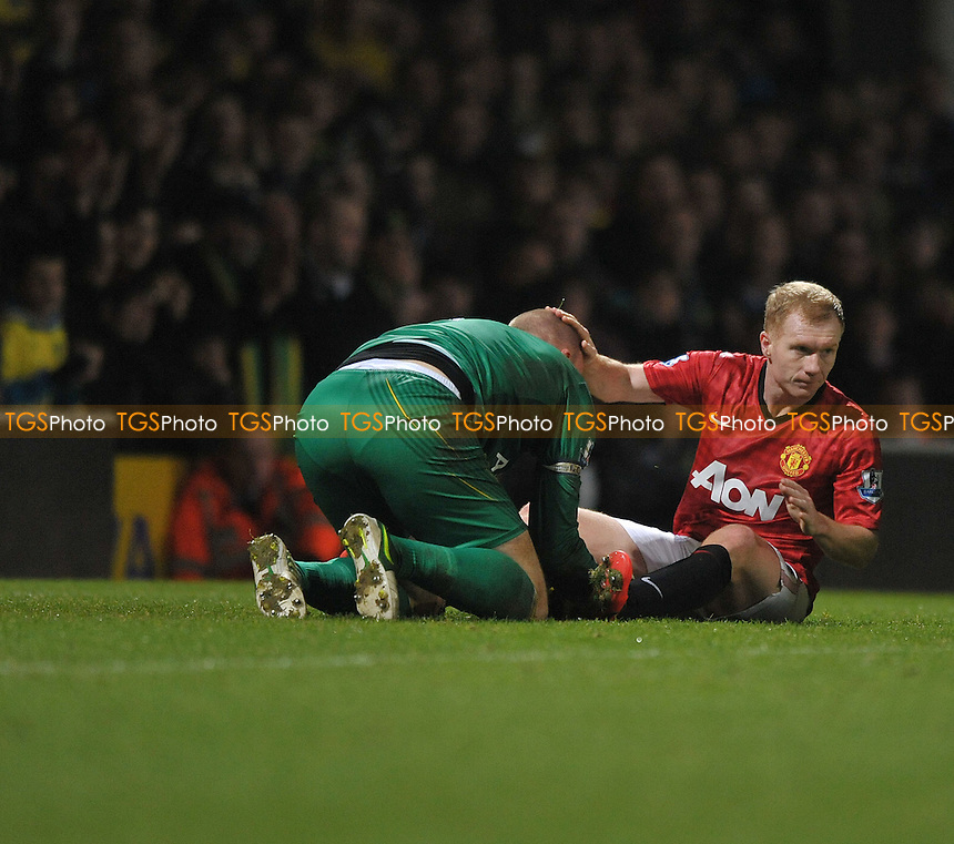 John Ruddy of Norwich City and Paul Scholes of Manchester United - Norwich City vs Manchester United - Barclays Premier League Football at Carrow Road, Norwich, Norfolk - 17/11/2012 - MANDATORY CREDIT: Martin Dalton/TGSPHOTO - Self billing applies where appropriate - 0845 094 6026 - contact@tgsphoto.co.uk - NO UNPAID USE.